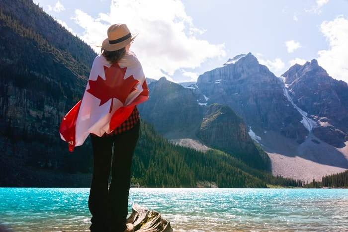 girl and the Canadian flag
