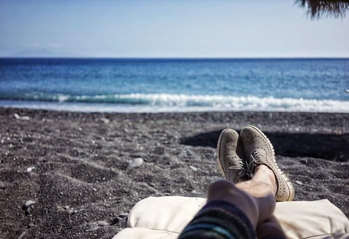 Man enjoying sitting in the shore
